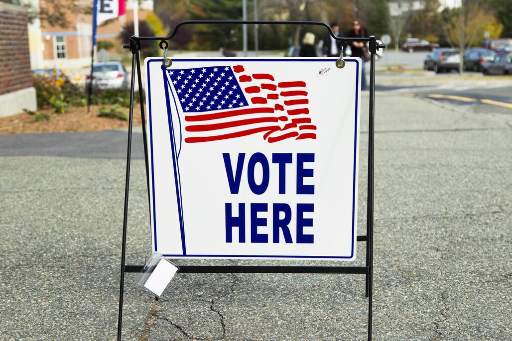 """vote here"" sign at polling location"