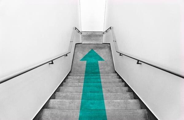 stairway with a green arrow
